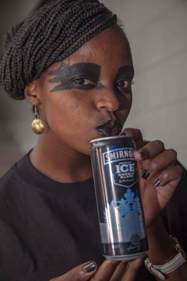 Suzzane King'ori dispays a can of the new Smirnoff Guarana