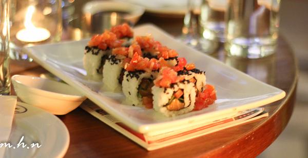 Salmon Tomato Roll A California roll-style sushi with rice, fresh salmon, onion & tomato